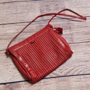 South American Lawrence Bentley red purse